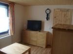 Wohnzimmer mit TV Monteurzimmer Windeck